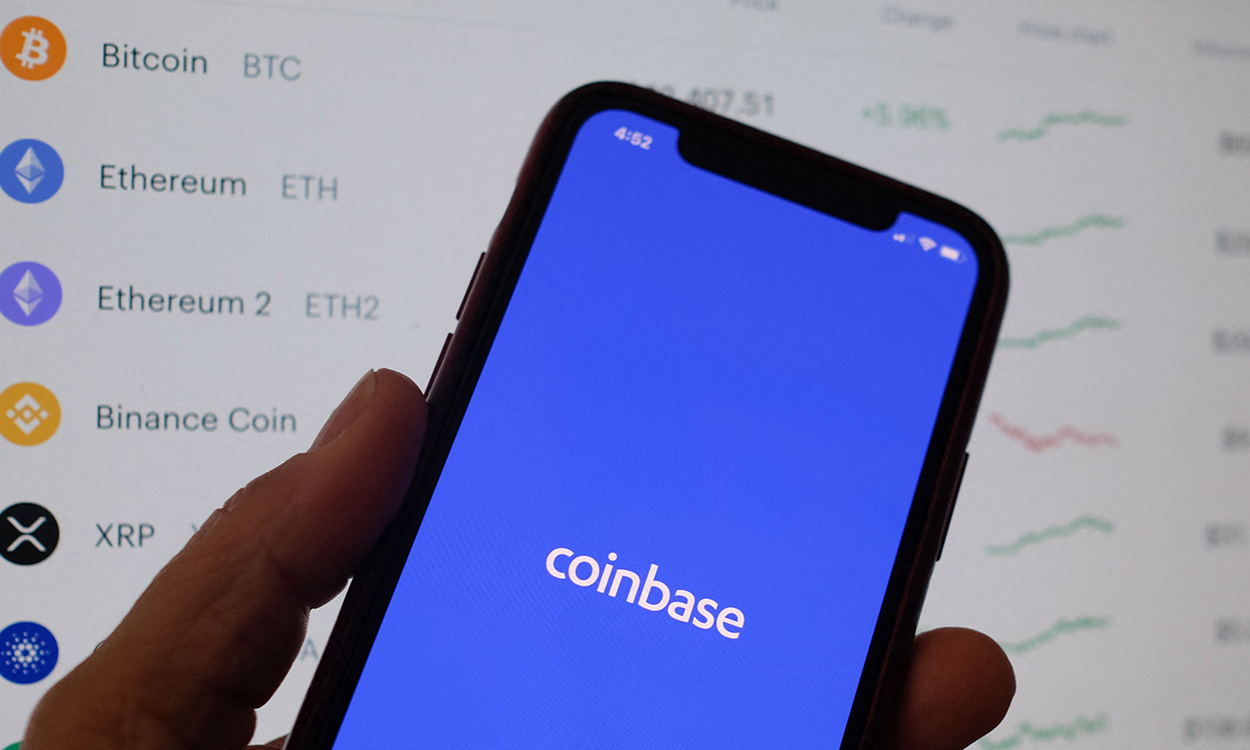 This illustration photo shows the Coinbase logo on a smartphone in Los Angeles on April 13, 2021. - The arrival April 13, 2021, of cryptocurrency exchange Coinbase on Nasdaq is one of the most anticipated events of the year on Wall Street, where enthusiasm for record-breaking bitcoin is in full swing, despite questions about the sustainability of the market. (Photo by Chris DELMAS / AFP)