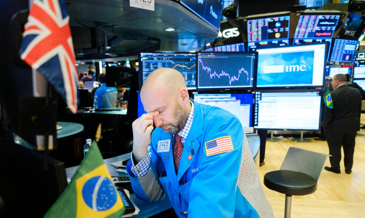 A trader rubs his eyes at the end of the day on the floor of the New York Stock Exchange in New York, New York, USA, 24 February 2020. Stocks around the world are broadly lower as investors are reportedly reacting to news that the coronavirus is spreading to more countries and the Dow Jones industrial average closed down over 1000 points.  EPA/JUSTIN LANE