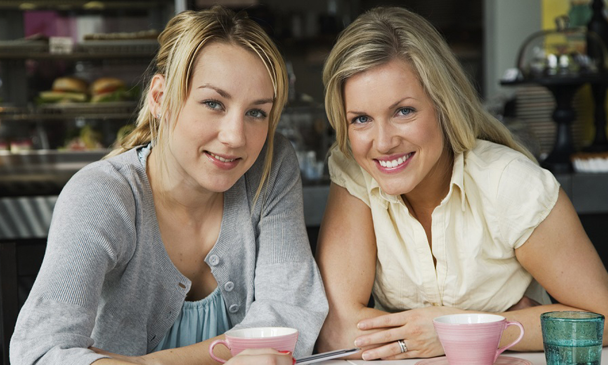 Two women having a business meeting and a cup of coffee in a caf, Sweden.