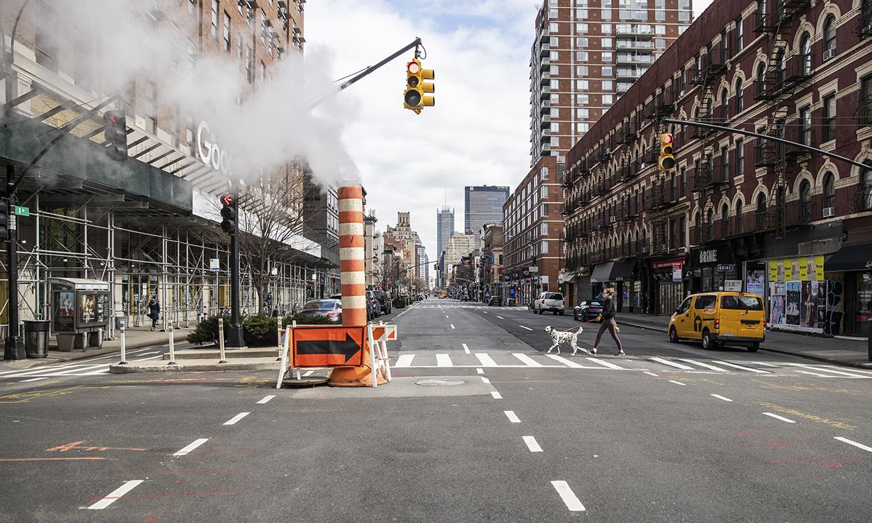 A quiet street in Manhattan, March 22, 2020. New York City and its suburbs account for roughly 5 percent of global cases, forcing officials to take urgent steps to stem the outbreak. (Jeenah Moon/The New York Times)