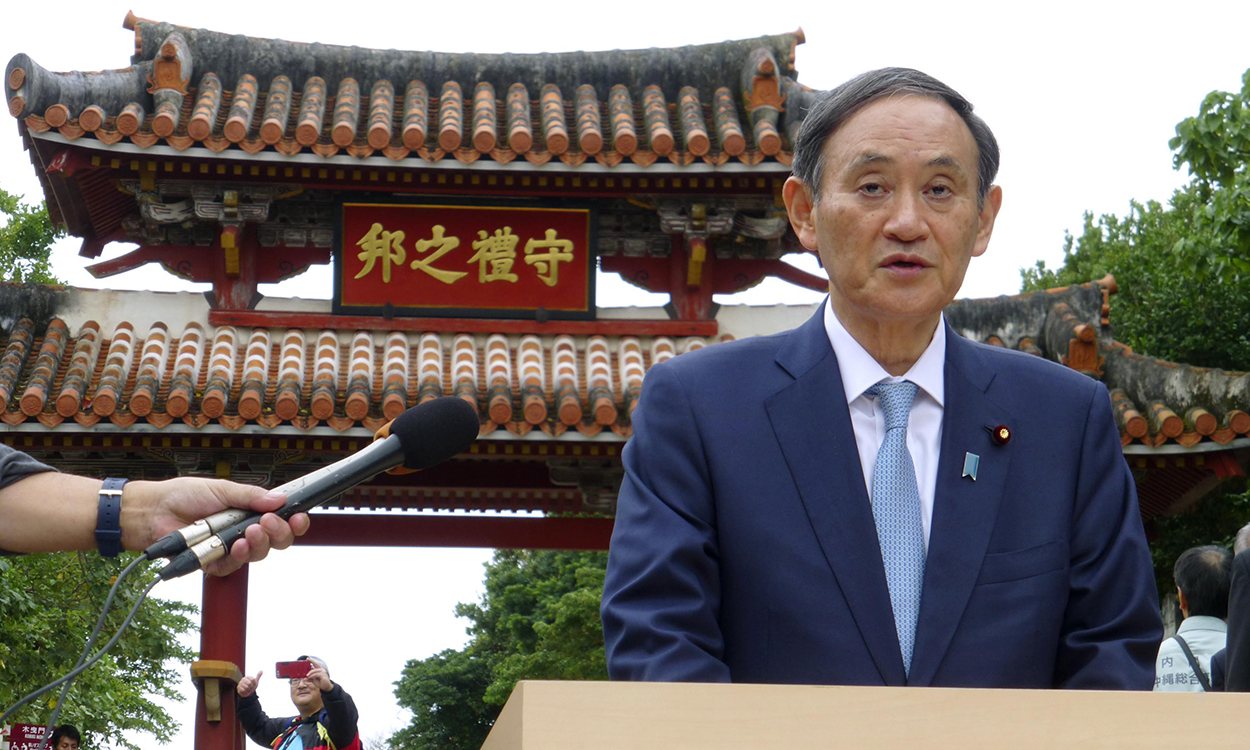 File photo taken in December 2019 shows Japanese Chief Cabinet Secretary Yoshihide Suga speaking to the media in Naha in Okinawa after inspecting Shuri Castle in the southern Japan prefecture, part of which was burned down by a fire in late October 2019. Suga won the Liberal Democratic Party's presidential election on Sept. 14, 2020, and is set to be appointed as prime minister by parliament two days later. (Kyodo)==Kyodo