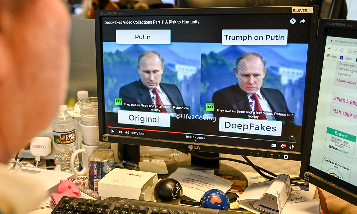 "A AFP journalist views a video on January 25, 2019, manipulated with artificial intelligence to potentially deceive viewers, or ""deepfake"" at his newsdesk in Washington, DC. - ""Deepfake"" videos that manipulate reality are becoming more sophisticated and realistic as a result of advances in artificial intelligence, creating a potential for new kinds of misinformation with devastating consequences. (Photo by Alexandra ROBINSON / AFP) / TO GO WITH AFP STORY by Rob LEVER ""Misinformation woes may multiply with  deepfake  videos"""