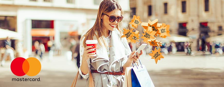 f21487c9 Bilde av kvinne med telefon med rabattstjerner over. Mastercard logo i  hjrnet.